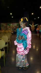 Daree wears an original Mardi Gras costume at the World of Mardi Gras in New Orleans, LA.