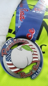 The commemorative 2014 AJC Peachtree Road Race medal